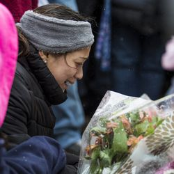 The family of Vicente Juarez, one of five people killed in a mass shooting at the Henry Pratt Company in Aurora, joins hundreds of mourners to pay their respects at a prayer vigil at the company, Sunday afternoon, Feb. 17, 2019.   Ashlee Rezin/Sun-Times