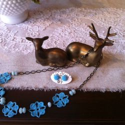Hand-crocheted necklace by Muggy Tuesday, $50; Resin flower earrings by Marsha Spaniel, $12
