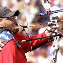 Eric Bennett of the United States prepares to fire an arrow at man's archery individual recurve standing bronze medal match at the 2012 Paralympics games, Monday, Sept. 3, 2012, in London. Bennett who shoots using his mouth to fire the arrows missed out on the bronze medal that was won by Mikhail Oyun of Russia.