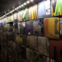 Recycled skate decks make up the front of the bar.