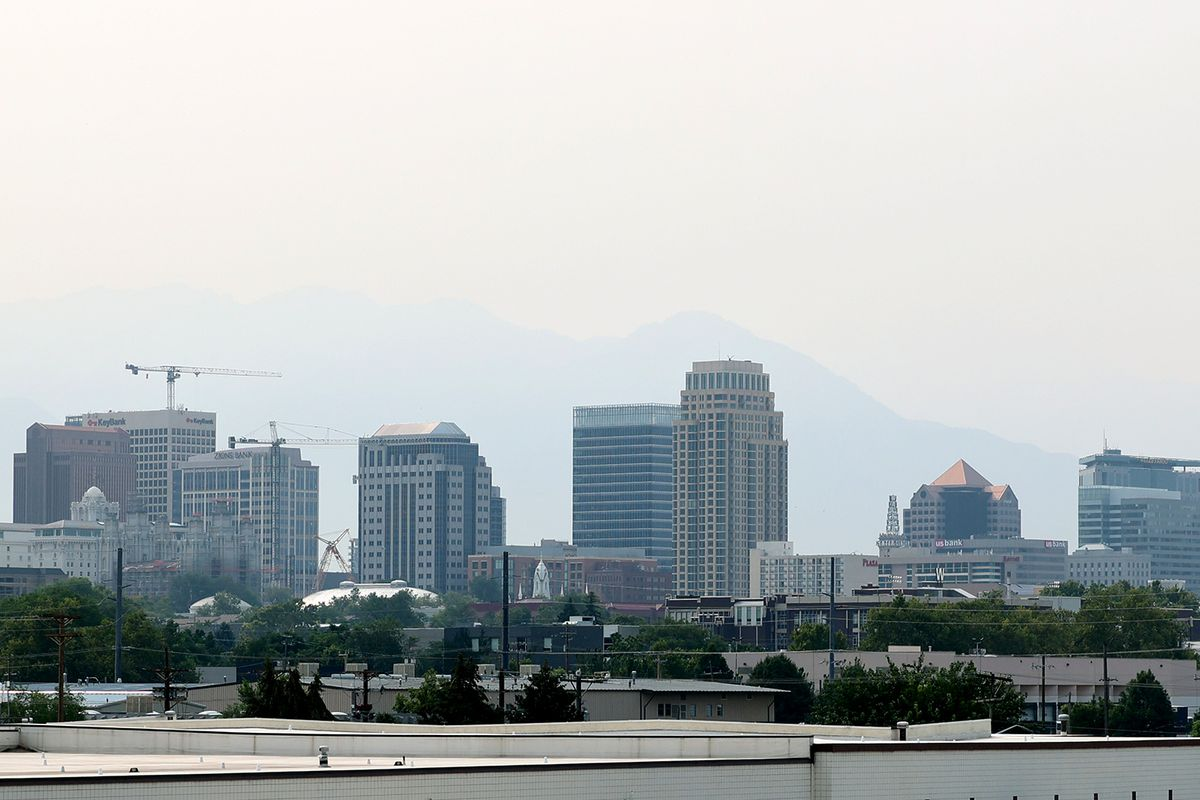 Smoke obscures the mountains behind the Salt Lake City skyline.