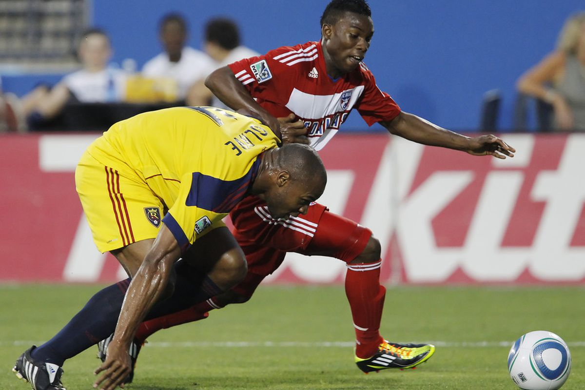 FRISCO, TX - MAY 22: Fabian Castillo #15 of FC Dallas battles to get past Jamison Olave #4 of Real Salt Lake during the first half of a soccer game at Pizza Hut Park on May 22, 2011 in Frisco, Texas. (Photo by Brandon Wade/Getty Images)