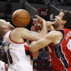 Portland Trail Blazers' Joel Przybilla (10) and New Jersey Nets' Kris Humphries (43) battle for a loose ball as Trail Blazers' LaMarcus Aldridge, left, watches during the first quarter of an NBA basketball game, Wednesday, April 4, 2012, in Portland, Ore.