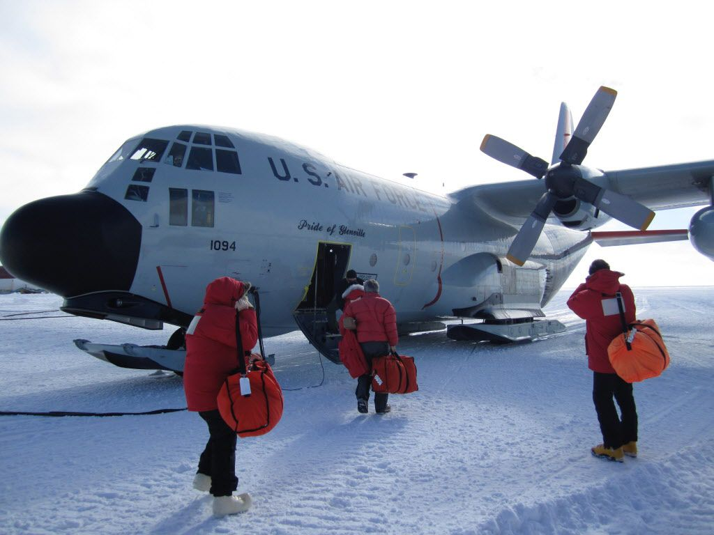 Peter Makovicky's team gets set to fly out from McMurdo Station, a U.S. research outpost in Antarctica, for their camp near the base of Mount Kirkpatrick in 2010.