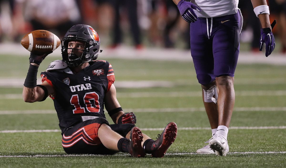 Utah wide receiver Britain Covey sits on the turf after a short gain Saturday night in Salt Lake City. Covey was on the receiving end of a number of big hits during Washington's 21-7 victory over the Utes at Rice-Eccles Stadium.