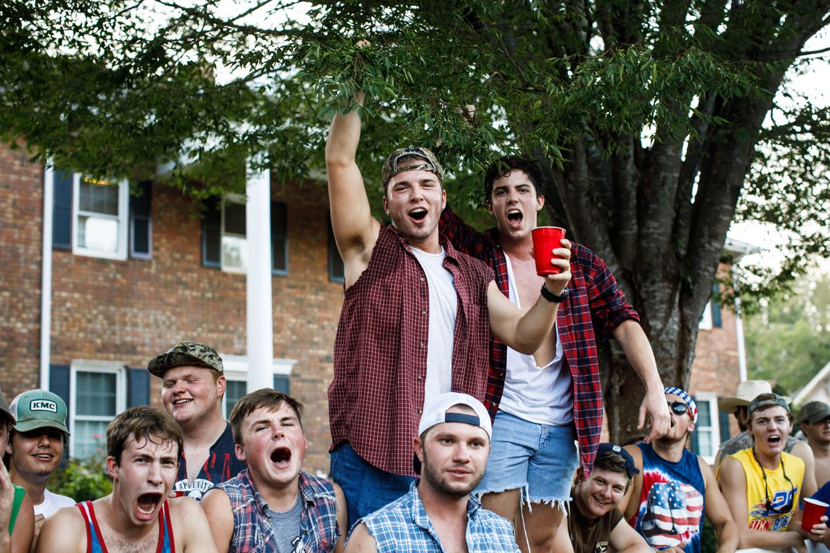 cf37fcfaf7a Fraternity members drive around campus in pickup trucks during sorority  rush.