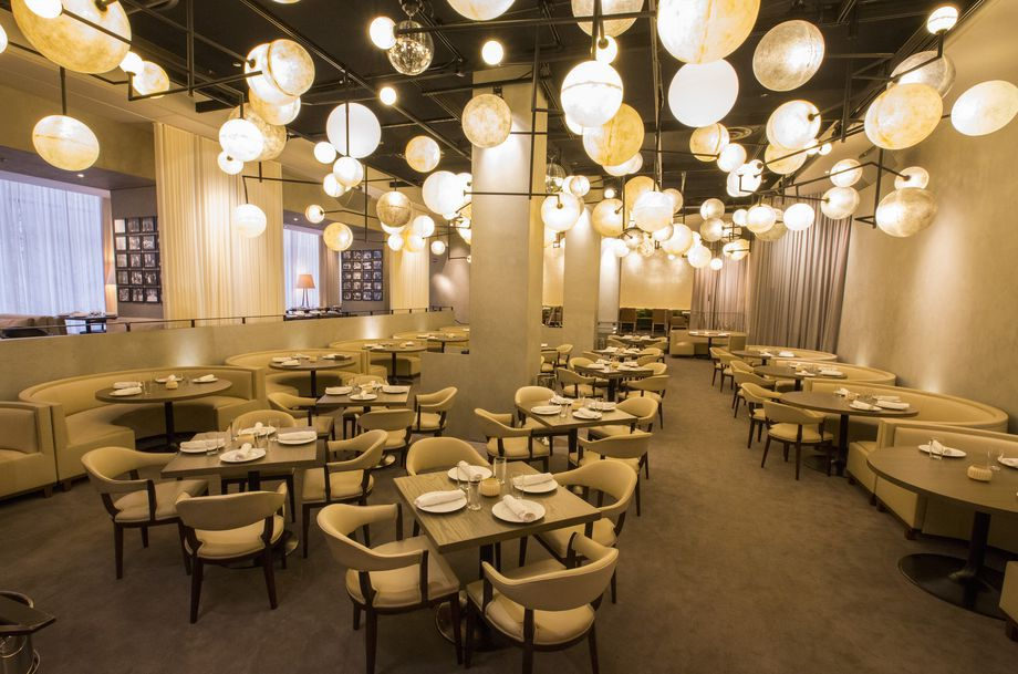 A fancy restaurant dining room with lots of circular lights.