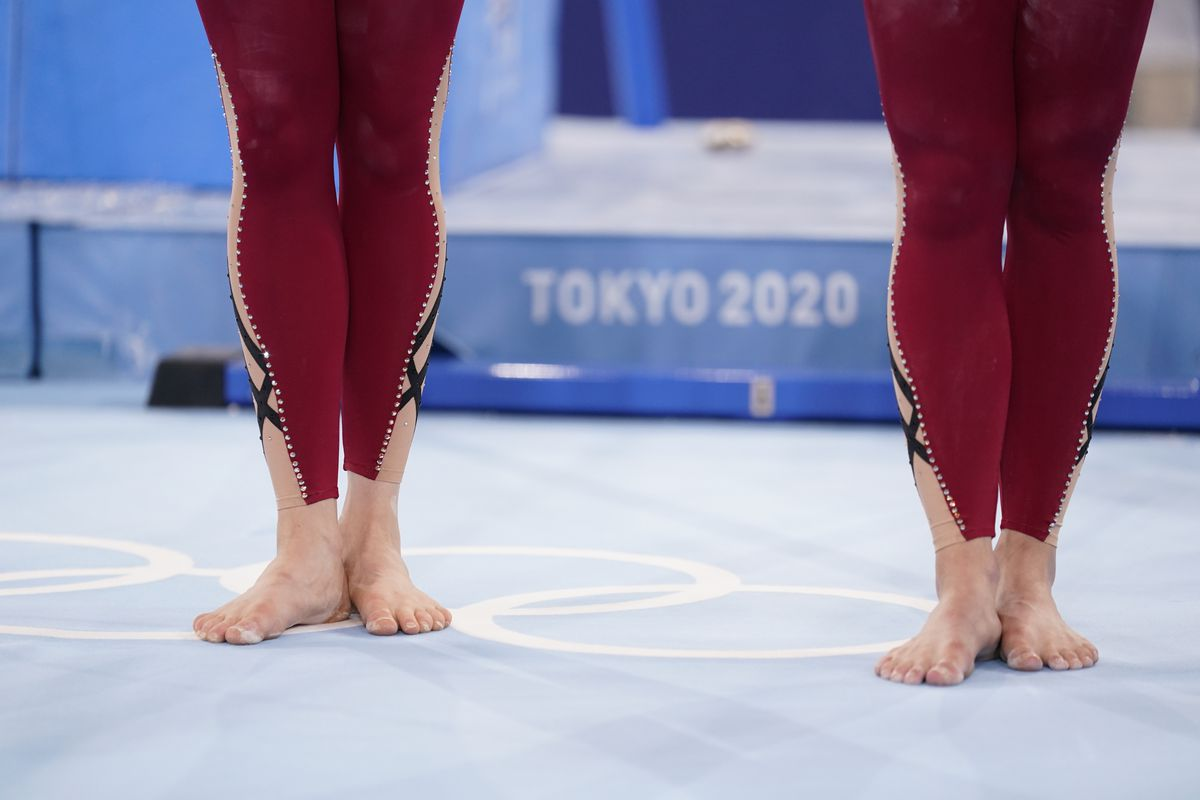 German gymnasts stand with their unitard costumes at the 2020 Summer Olympics, Sunday, July 25, 2021, in Tokyo.