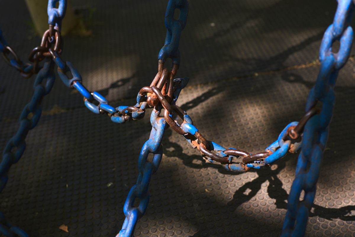 Paint peels off a climbing chain at the Marlboro Houses in Brooklyn, July 14, 2020.