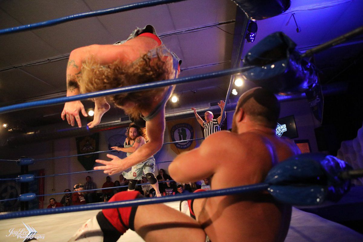 One of the Hooligans hits a cannonball on Jaka at a Beyond Wrestling event