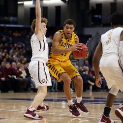 Loyola's Quinn Pemberton (11) drives around St. Ignatius's Parker Higginbottom (1) in their 56-46 win at Northwestern University in Evanston, Friday, February 8, 2019.   Kevin Tanaka/For the Sun Times
