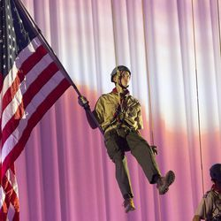 Flag bearers are lowered from the roof for the flag ceremony. Thousands of scouts and their leaders assemble Tuesday, Oct. 29, 2013 in the Conference Center in Salt Lake City to celebrate a century of honor.