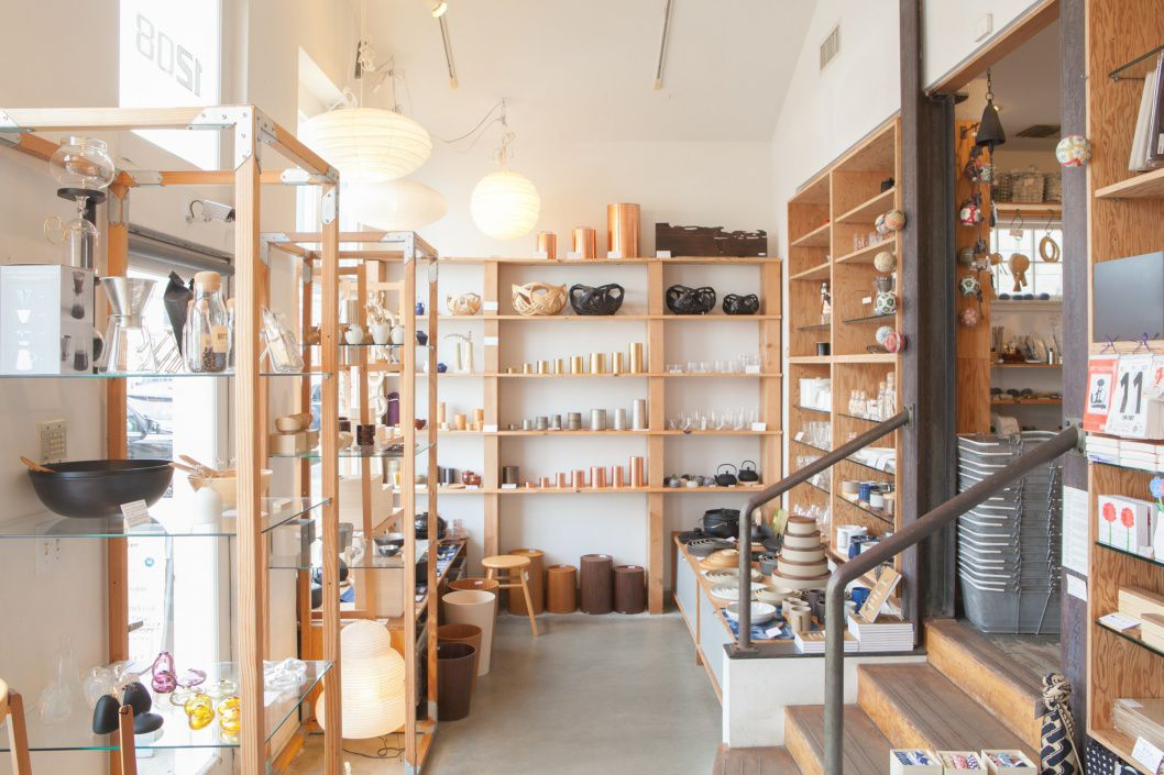 Multiple wooden shelves with various homeware items arranged on display.
