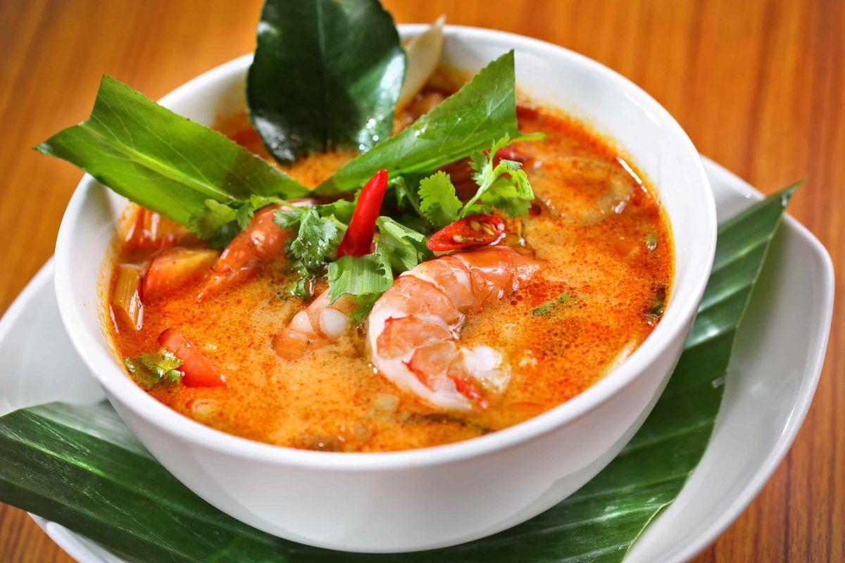 A big bowl of Thai soup with shrimp