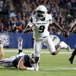 South Florida Bulls quarterback Timmy McClain (9) runs away from Brigham Young Cougars defensive lineman Fisher Jackson (53) as BYU and USF play a college football game at LaVell Edwards Stadium in Provo on Saturday, Sept. 25, 2021. BYU won 35-27.