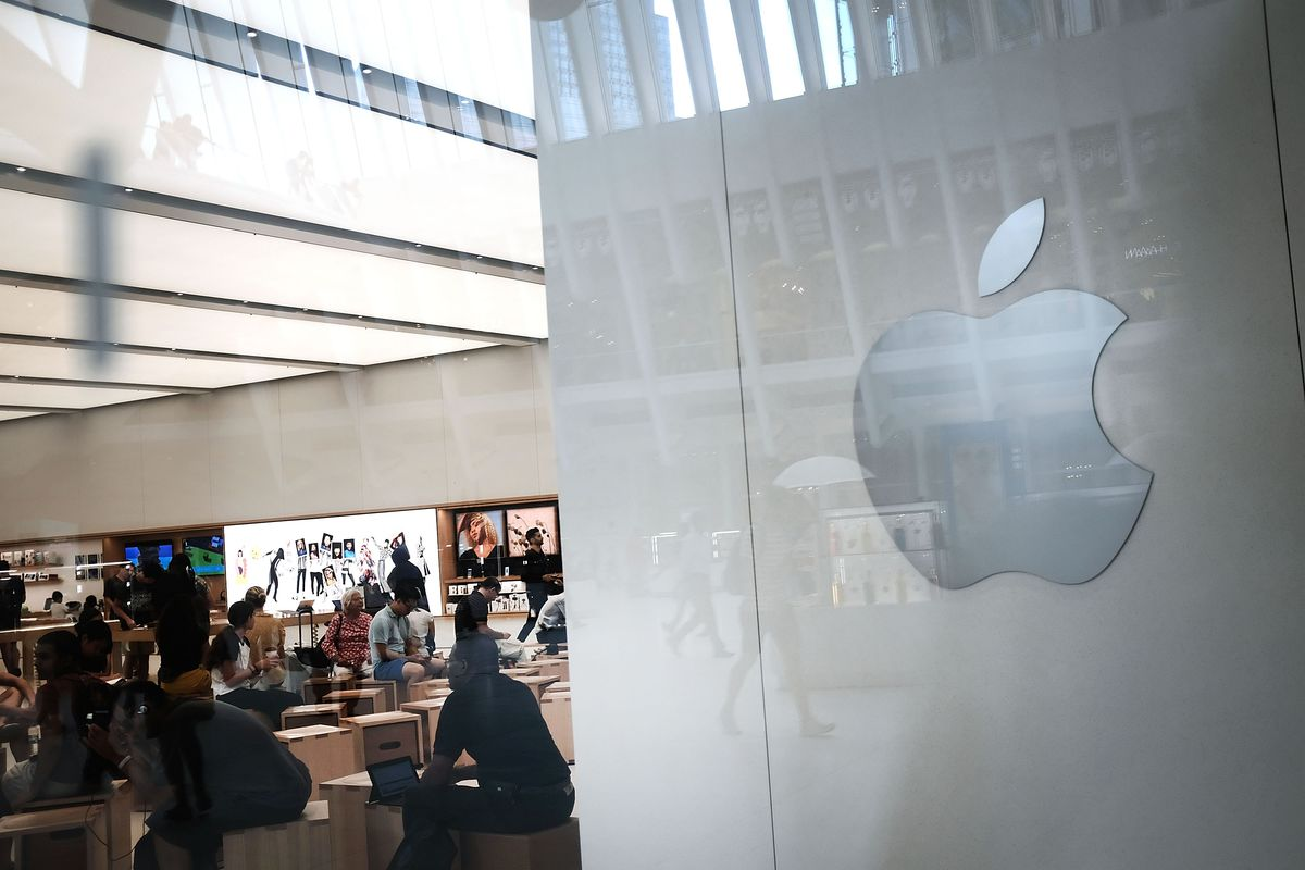 The Apple logo is displayed in an Apple store in lower Manhattan