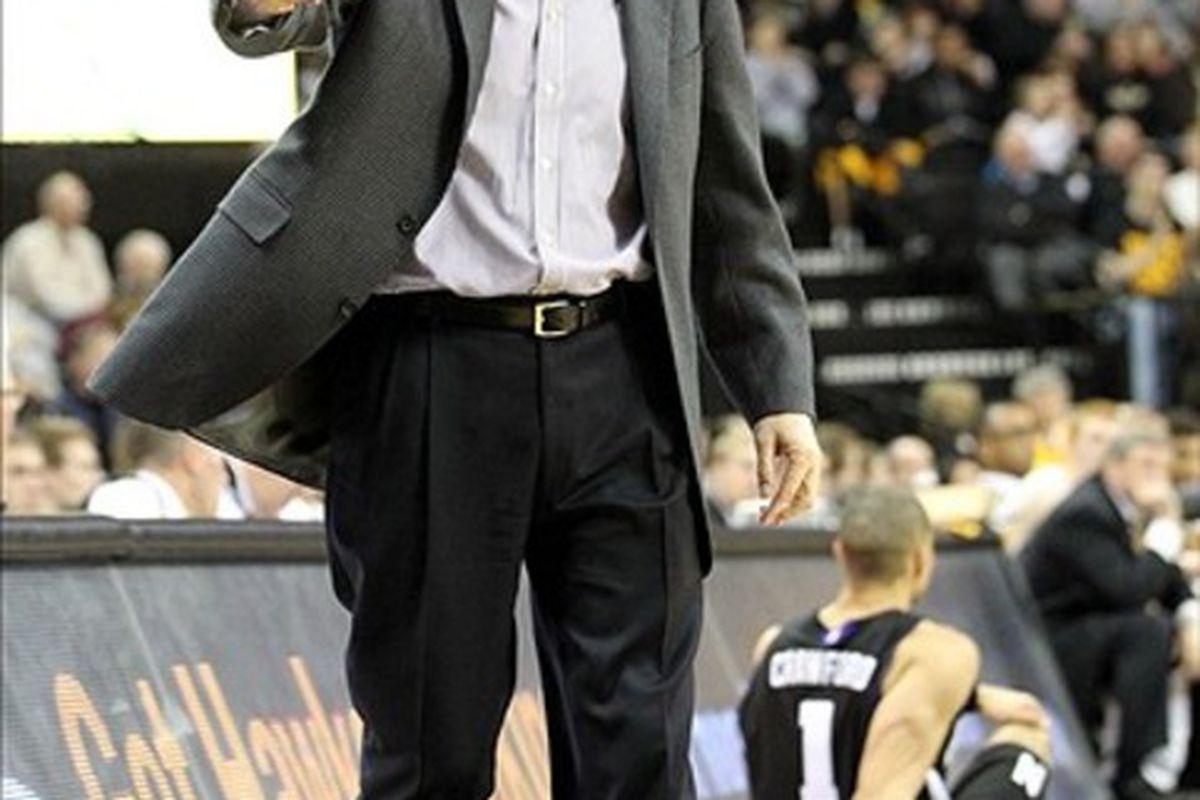 March 3, 2012; Iowa City, IA, USA; Northwestern Wildcat coach Bill Carmody reacts during the game against the Iowa Hawkeyes at Carver Hawkeye Arena.   Northwestern beat Iowa 70-66.  Mandatory Credit: Reese Strickland-US PRESSWIRE