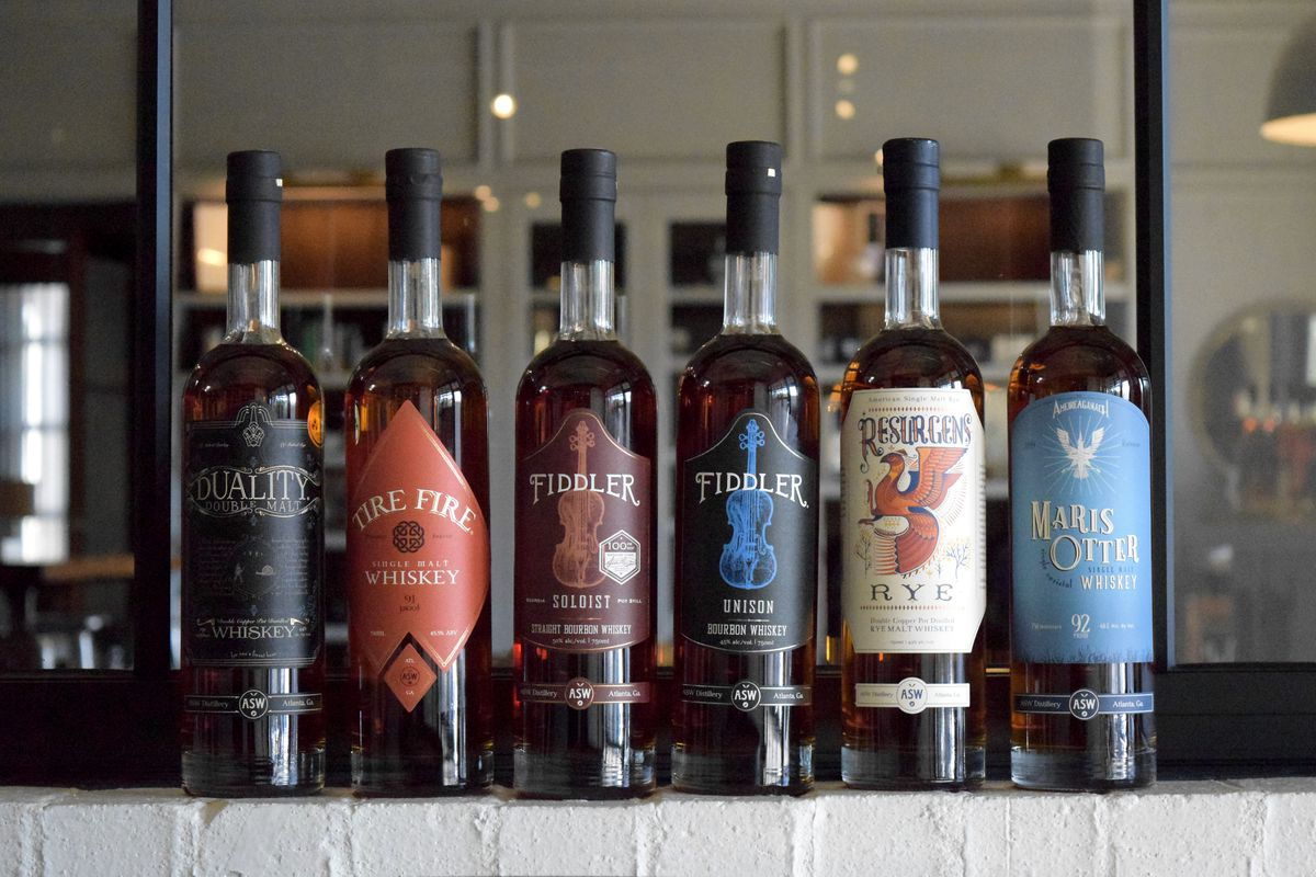 Six full bottles of ASW whiskey in a row