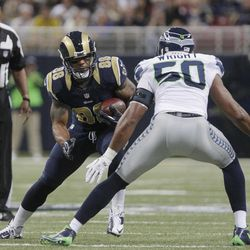 St. Louis Rams tight end Lance Kendricks is defended by Seattle Seahawks outside linebacker K.J. Wright during the first half of an NFL football game Sunday, Sept. 30, 2012, in St. Louis.