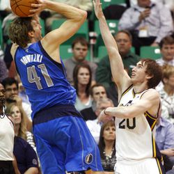 Utah Jazz guard Gordon Hayward (20) tries to get a hand up at Dallas Mavericks forward Dirk Nowitzki (41) as he raises up for a shot as the Utah Jazz and the Dallas Mavericks play Monday, April 16, 2012 in Salt Lake City.