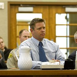 Michael Pratt, center, and his two lawyers, Jeremy Delicino, left, and Stephen McCaughey, right, wait for the judge's final decision for Pratt's sentence Monday at the Fourth District Court in American Fork. Pratt was sentenced to 5 years to life in prison.