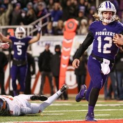 Lehi quarterback Cammon Cooper runs the ball in for a touchdown, putting Lehi up 14-0 over Skyridge after the PAT, in the 5A football state championship game at Rice-Eccles Stadium in Salt Lake City on Friday, Nov. 17, 2017.