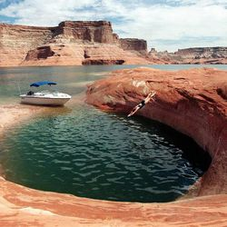 Sarah Wallace dives into a pool at Lake Powell in September 1997. There has been debate on whether recreation areas and national parks in Utah should be opened and run by the state during the federal government shutdown.