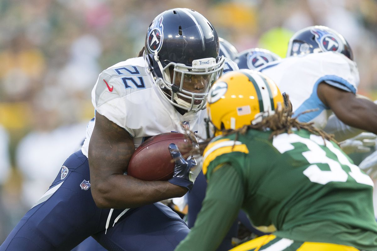 Tennessee Titans running back Derrick Henry (22) rushes with the football as Green Bay Packers cornerback Davon House (31) defends during the first quarter at Lambeau Field.
