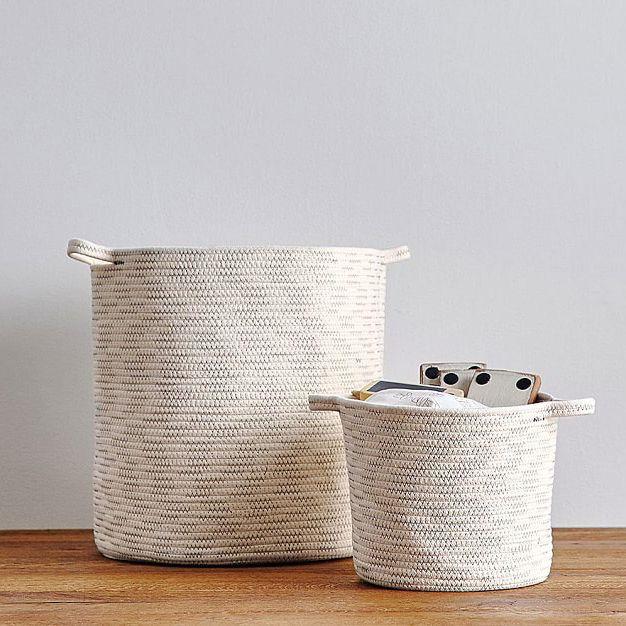 Off-white rope storage bins.