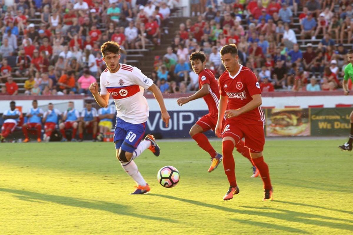 USL Photo - TFC II's Matt Srbely matches the run of Richmond's Matthew Bolduc on Saturday at the City Stadium in Virginia