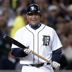 Detroit Tigers' Miguel Cabrera smiles while being intentionally walked by the Oakland Athletics during the third inning of a baseball game in Detroit, Wednesday, Sept. 19, 2012.