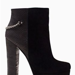 """<a href=""""http://www.nastygal.com/product/vicious-chained-bootie/_/searchString/shoe%20cult"""">Vicious Chained Bootie</a>, $120.00"""