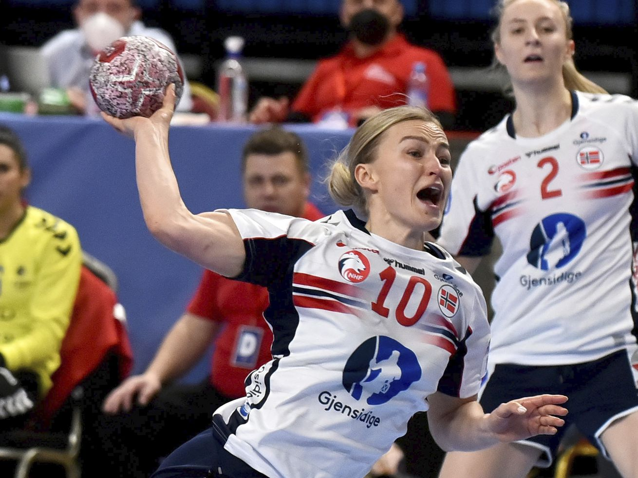 Norway's Stine Bredal Oftedal tries to score during a women's handball Olympic qualifying match between Norway and Romania.