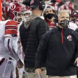 Utah head coach Kyle Whittingham, right, stands near quarterback Jake Bentley (8) during the first half of the team's NCAA college football game against Washington, Saturday, Nov. 28, 2020, in Seattle.