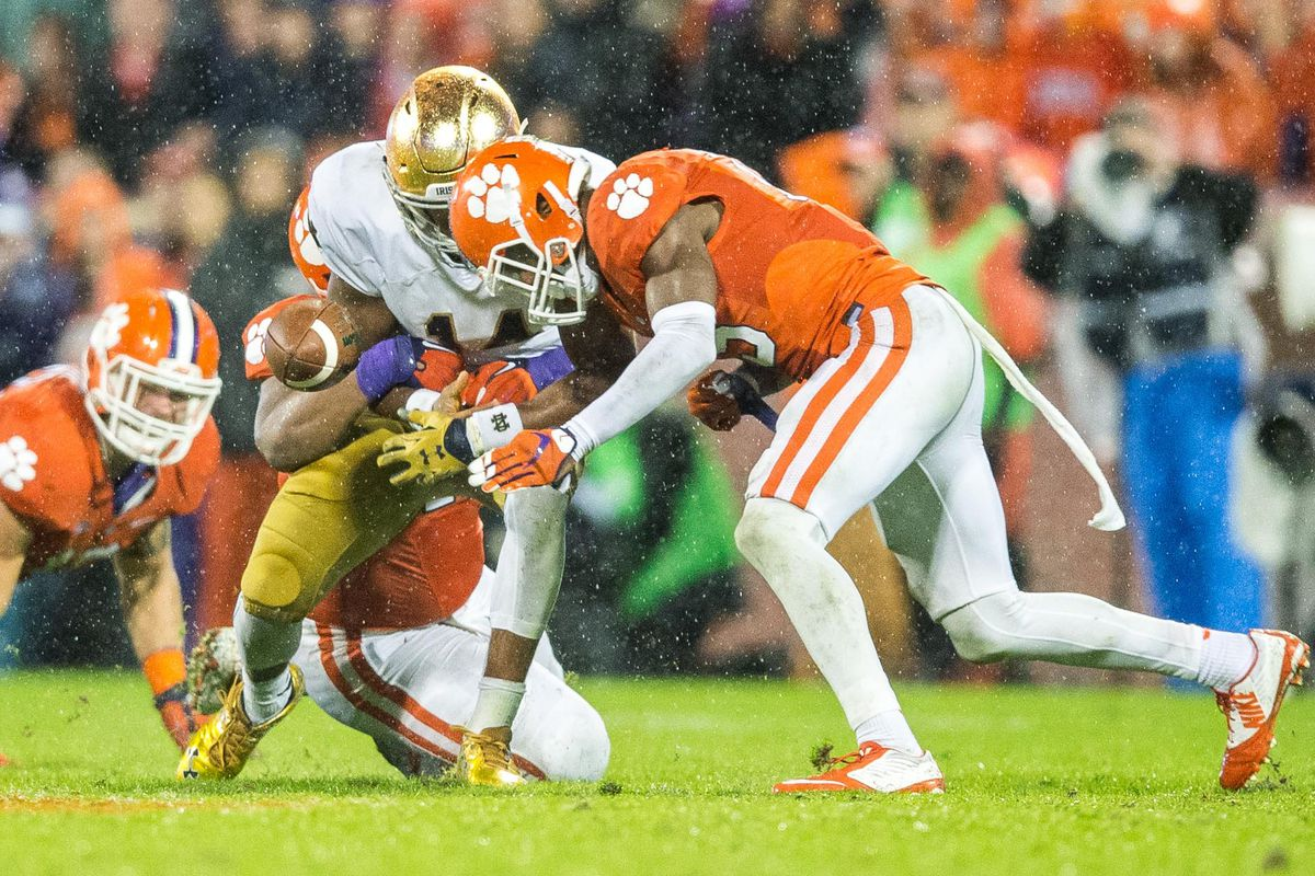 Christian Wilkins knocks the ball out of Kizer's hands.