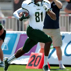 South Florida's Andre Davis (81) scores on a 51-yard reception against Nevada during the first half of an NCAA college football game Saturday, Sept. 8, 2012, in Reno, Nev.