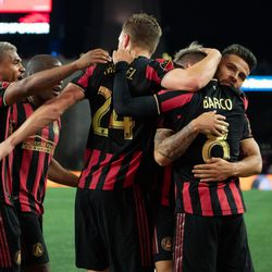 FOXBOROUGH, MA - APRIL 13: Atlanta United FC midfielder Julian Gressel #24 celebrates with Ezequiel Barco #8 after his first half goal against the New England Revolution at Gillette Stadium on April 13, 2019 in Foxborough, Massachusetts. (Photo by J. Alexander Dolan - The Bent Musket)