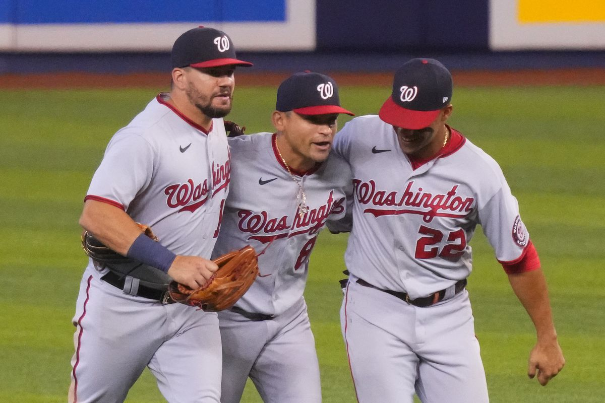 Kyle Schwarber #12, Gerardo Parra #88, and Juan Soto #22 of the Washington Nationals celebrate the win against the Miami Marlins by score of 5-1 at loanDepot park