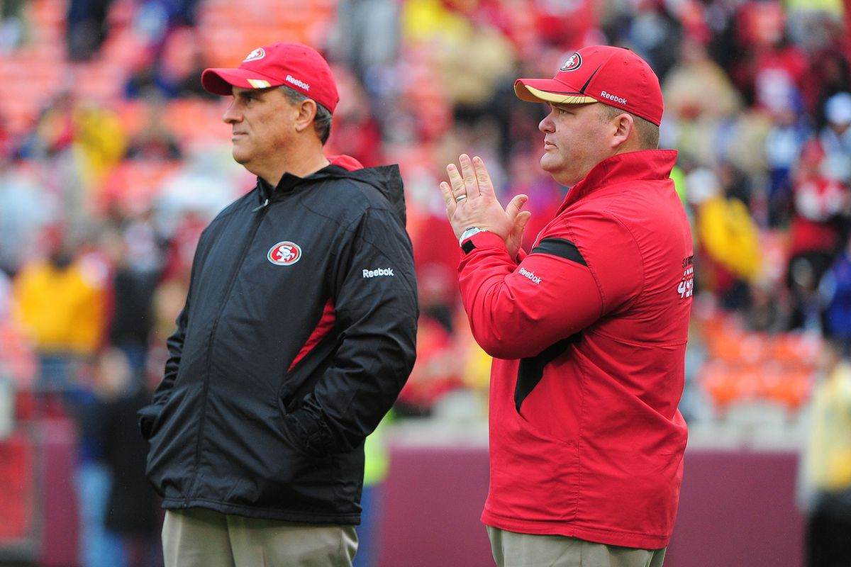 Jan 22, 2012; San Francisco, CA, USA; San Francisco 49ers defensive coordinator Vic Fangio (left) and offensive coordinator Greg Roman (right) watch warm ups before the 2011 NFC Championship game against the New York Giants at Candlestick Park.