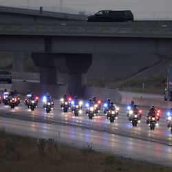 A motorcade escorts Vice President Mike Pence from Salt Lake City International Airport on eastbound I-80 in Salt Lake City on Monday, Oct. 5, 2020.