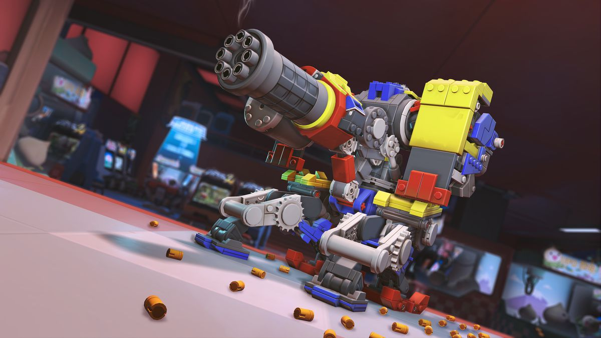 Bastion fires in turret form in his colorful Lego-inspired Brick Bastion skin inside the Hanamura arcade in a screenshot from Overwatch.