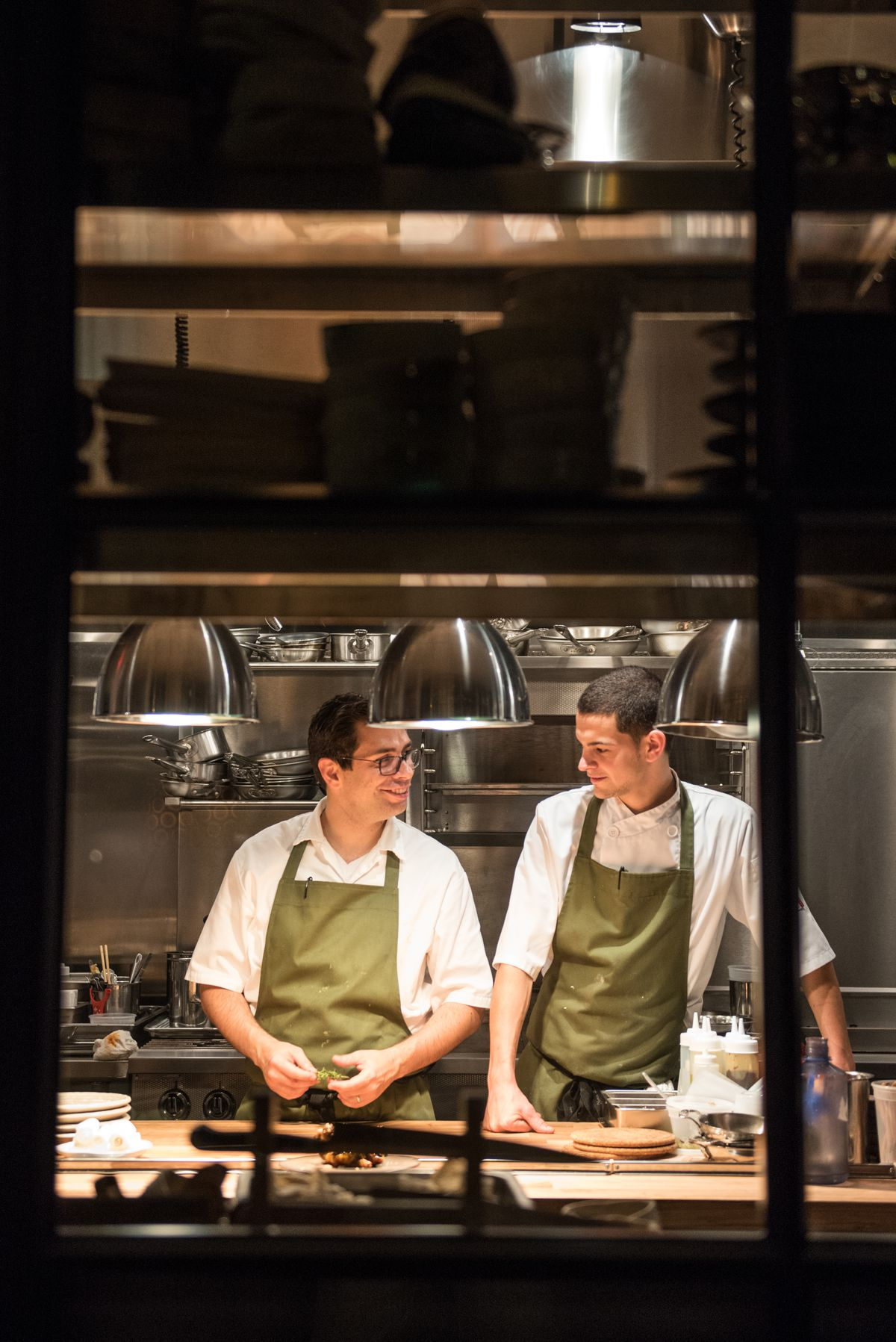 Chef Rob Rubba, left, during his time at Hazel