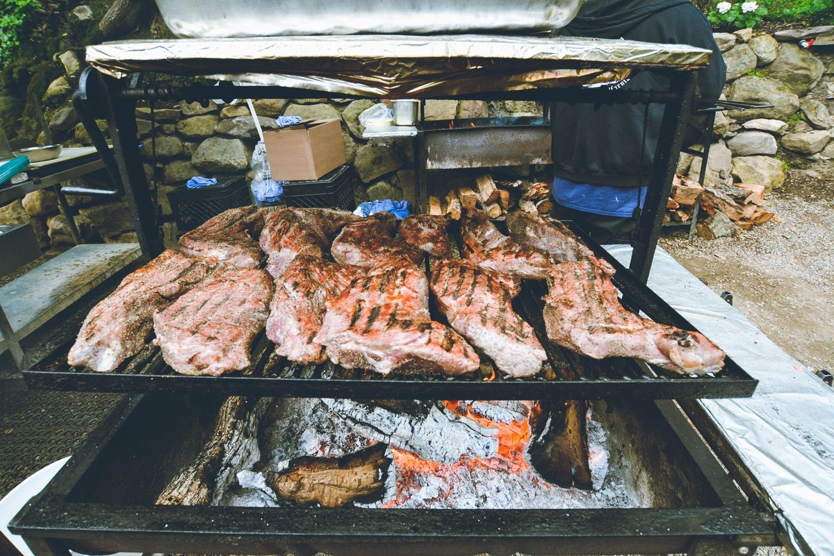 Cold Spring Tavern's outdoor open grill with lots of tri-tip on top.
