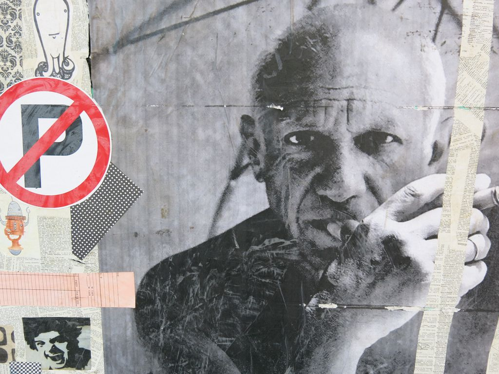 Picasso mural wherein the famed artist is smoking a cigarette.