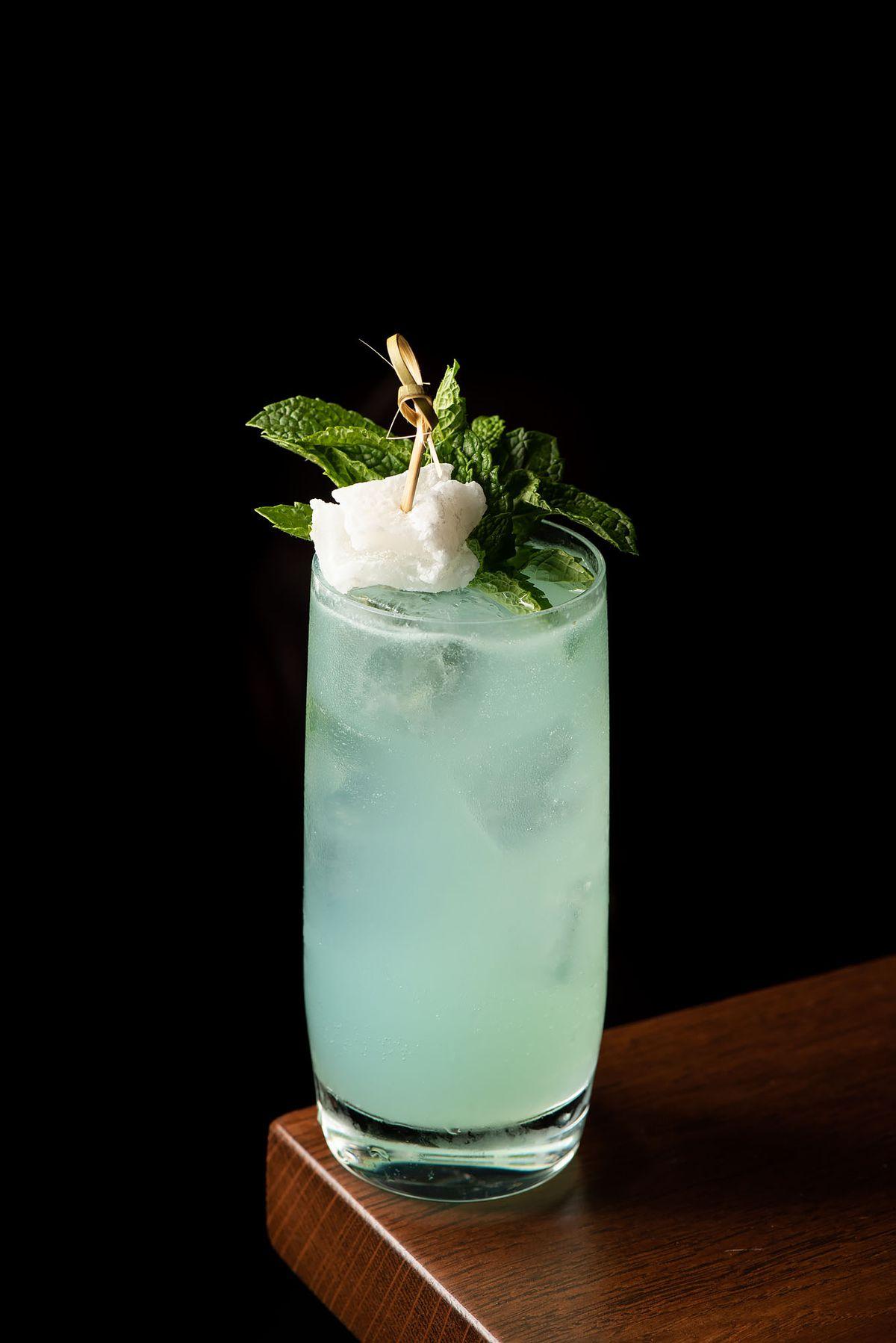 Mixtape light blue cocktail mint corner of table