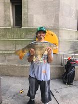 Jeffrey Williams with a Chicago River carp. Provided photo