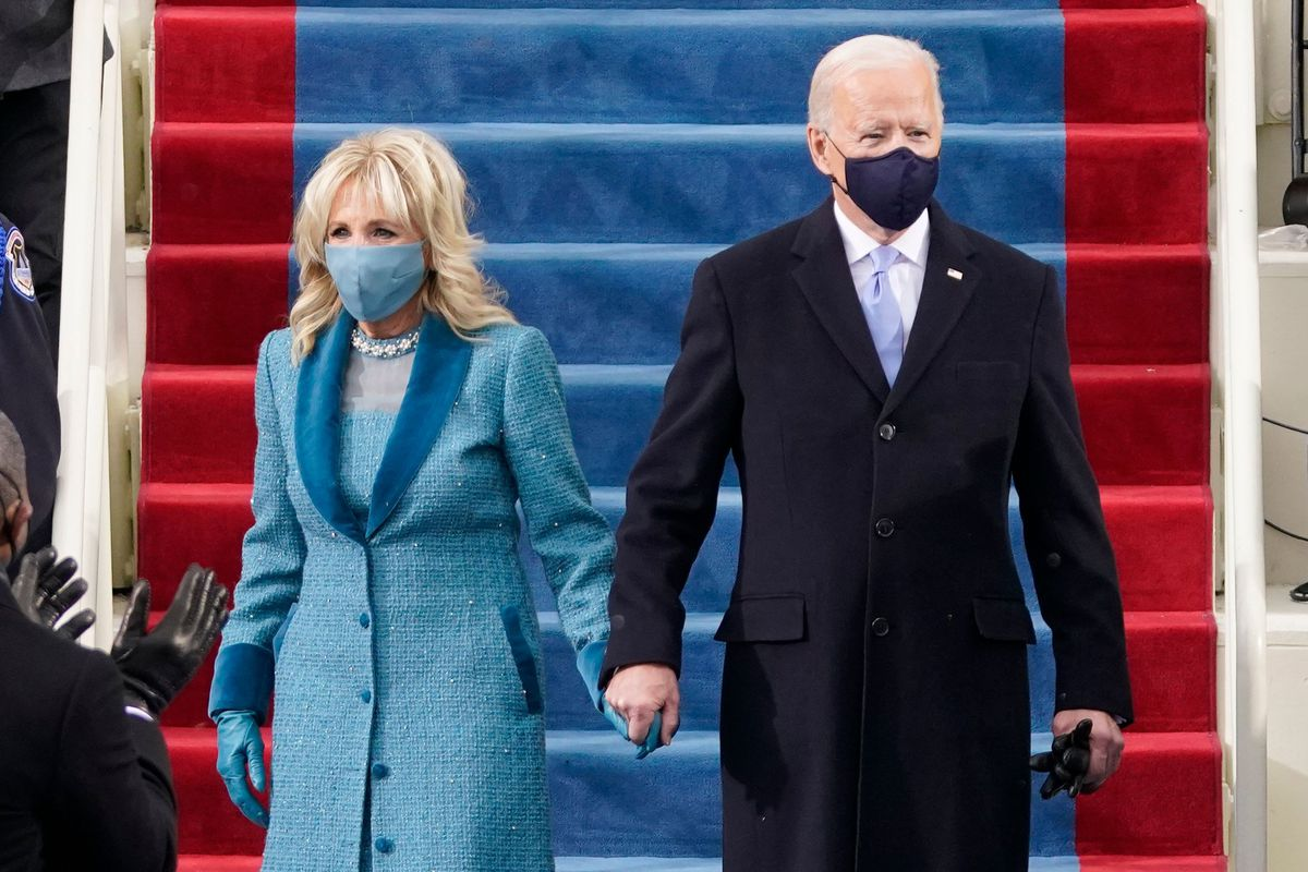 President-elect Joe Biden flanked by wife Dr. Jill Biden arrives for his inauguration as the 46th US President on January 20, 2021, at the US Capitol in Washington, DC.