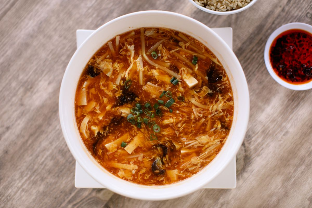 chinese style hot and sour soup in white bowl