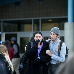 Students exit Pleasant Grove High School after a lockdown at the high school was lifted Thursday, Dec. 3, 2015. Pleasant Grove High School was placed on lockdown after receiving reports of a man with a weapon inside the school.