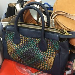 Leather satchel with woven detail, $130